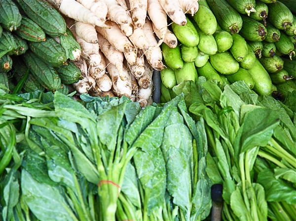 Assortment Of Green Vegetables On A Market Stall